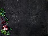 Kale, pomegranate, jalapeno and parsley background