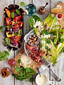 Salad with grilled vegetables and Ceasars salad with spinach, parmesan, bacon and croutons