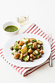 New potatoes with olives and rocket pesto