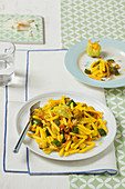 Penne with zucchini, zucchini flowers, saffron and curry