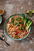 Rice noodle salad with bean sprouts, coriander, carrots, red pepper and pak choi