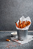 Oven baked sweet potato fries with smoked paprika and cayenne pepper, sea salt and sour cream
