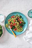 Vegan kale pesto and slow roasted tomato pasta