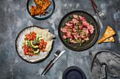 Beef carpaccio, salmon sashimi
