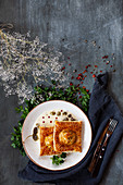Puff pastry with trout lemon sauce and capers