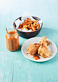Crisp baked chicken with rosemary sweet potatoes and ketchup