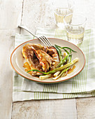 Chicken in white wine sauce with spring onions
