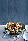 Spelt spaghetti with chilli, sprouting broccoli and pancetta
