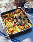 Fish casserole with potatoes, tomatoes and herbs