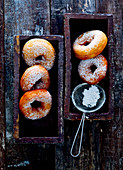 Donuts with powdered sugar and a sieve