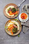 Veal medallions in a herb crust with carrot salad and mashed potatoes