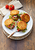Veggie burgers with tuna and tomato salad