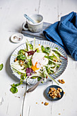 Fennel salad with poached egg and walnuts (keto cuisine)