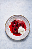 Marsala-baked plums with chantilly cream