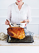 Preparation Baked Cherry Ham: brush the ham with glaze