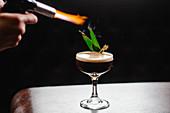 Espresso martini with flambéed pandan leaves