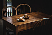 Coffee and pastry on wooden table in cafe