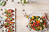 Spiced honey roasted sweet potatoes with tahini dressing and Chargrilled vegetable salad with whipped basil fetta