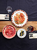 Olives, wine, a swirl of Iberico and pan con tomate