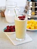 Mango smoothie with raspberries