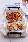 Crostini with bell pepper and tomato salad