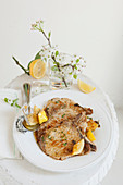 Pork chop with lemon butter, thyme, rosemary and honey