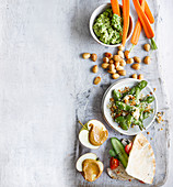Healthy snacks - Crushed pea and mint dip with carrot sticks, Pitta pocket, Roasted edamame