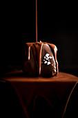 Chocolate flows on a mini chocolate cake