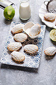 Lime madeleines with powdered sugar