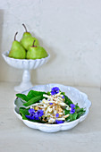 Kohlrabi and pear salad with cornflowers