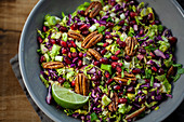 Red cabbage salad with pecan nuts, lime and pomegranates
