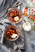 Honey plums with pecan nuts and cream