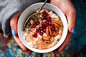 Porridge with pecan nuts and pomegranate