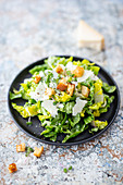 Caesar salad (romaine lettuce with anchovy dressing and parmesan)