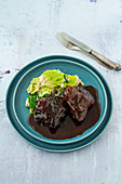 Braised veal cheeks with savoy cabbage