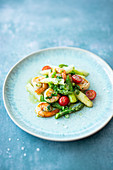 Asparagus salad with shrimps, cherry tomatoes and basil dressing