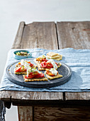 Crackers with anchoïade, tomatoes and mozzarella