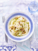 Fregnacce reatine (wide pasta with artichokes, Italy)