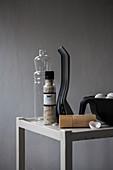 Kitchen utensils, salt mill, bottle and eggs on grey table