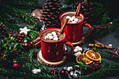 Hot chocolate with marshmallows in red enamel mugs
