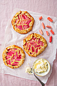 Rhubarb and almond galette with clotted cream, view from above.