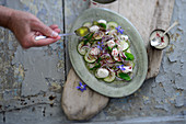 Cucumber salad with yoghurt and red onions