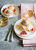 Pears wrapped in puff pastry with hazelnut ice cream and redcurrants