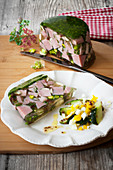 Ham terrine with honey and mustard gherkins and egg