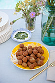 Fried olives with a green yoghurt sauce