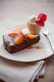 Chocolate cake with caramelised peaches