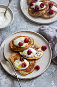 Banana and yogurt pancakes with yogurt, honey and raspberries