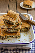 Borek cake with beetroot leaves and feta cheese, blach sesame seeds