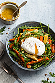 Roasted vegetables salad with lentils - roasted carrots, parsnip and celeriac, rocket, lentils and poached egg