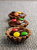 Chocolate tartelette with smarties